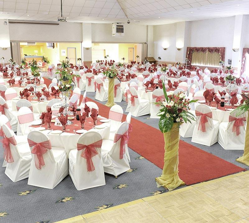 A hospitality suite at Wolverhampton Racecourse decorated in white and pink waiting for wedding guests to arrive,